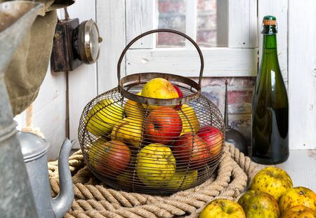 organic fresh apples with a  bottle of Normandy cider Imagens - 88879625