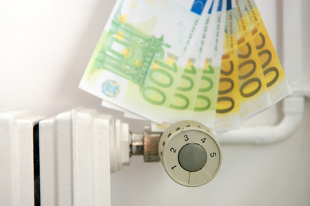 an heating thermostat with euros, expensive heating concept Stock Photo