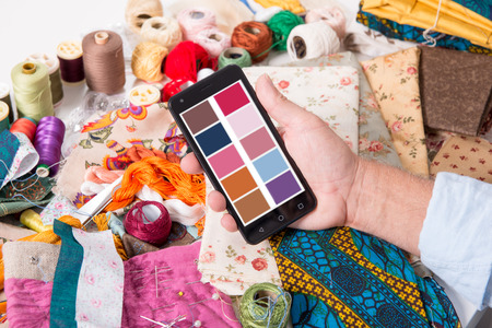 aa man fashion designer working with smartphone