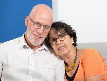 an happy senior couple in love, in their home Stock Photo