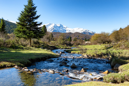 a river with Pic du Midi de Bigorre in the french Pyrenees