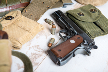 A handgun M1911 government with the ammo