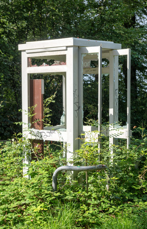 an old phone booth in the French countryside