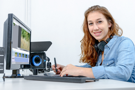 young woman designer using a graphics tablet for video editing