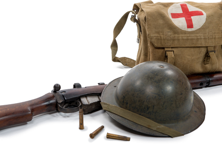 a british helmet, bag and rifle of World War II, on white