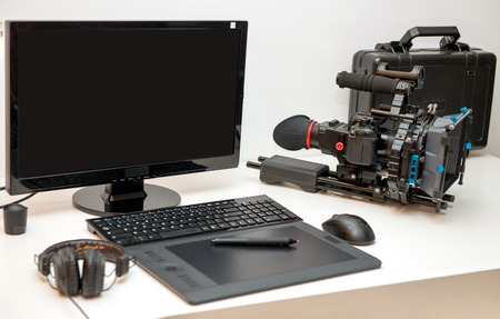 a camera, computer and tablet for video editing