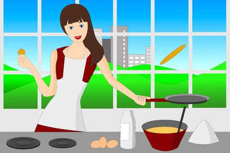 A woman flipping pancakes in the kitchen Stock Photo