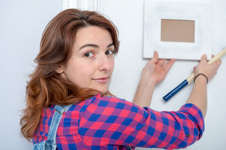 a young woman doing DIY work at home Stock Photo