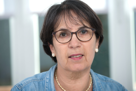 a portrait of middle age brunette with glasses