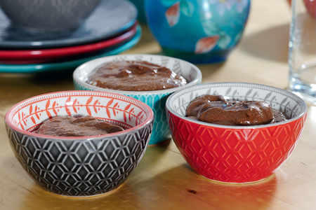 close up of cups with a dark chocolate mousse