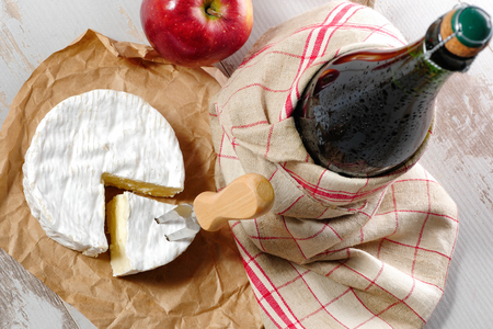 Camembert and a cider bottle from Normandy or Bretagne Stock fotó - 96734348