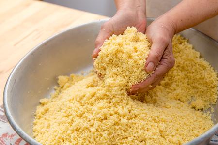 semolina preparation for delicious couscous Archivio Fotografico