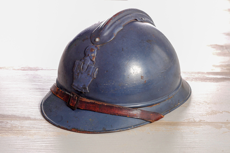 a french military helmet of the First World War on the wooden table
