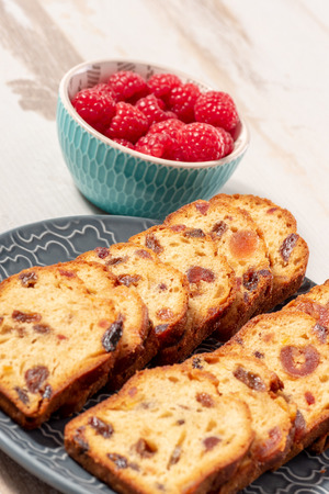 delicious dried fruit cake sliced with raspberries Archivio Fotografico