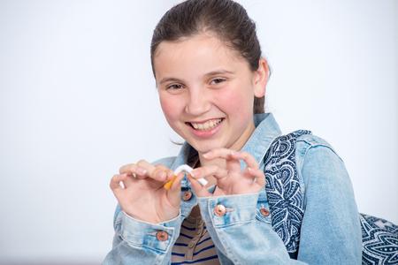 happy young teenage girl breaking a  cigarette Stock fotó