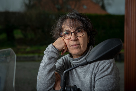 a portrait of a mature woman in the dim light Reklamní fotografie