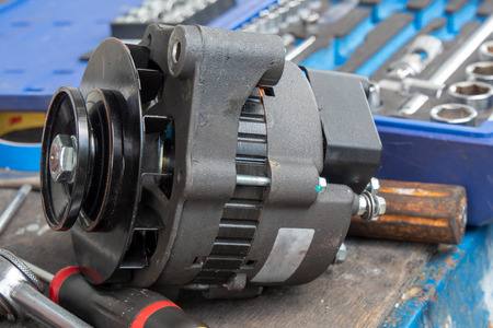 a car alternator repaired on the workbench Foto de archivo - 104947215