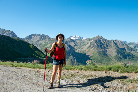 a woman hiker on the trail of  Pic du Midi de Bigorre in the Pyrenees