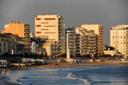a view of Les Sables d'Olonne buildings at sunset Stock Photo