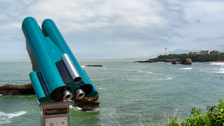 a view of lighthouse on rocky coast of Biarritz, Basque, France Stock Photo