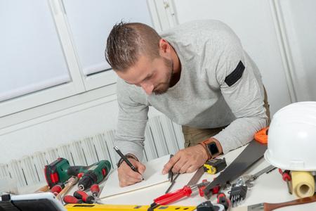 a smiling young handyman DIY at home