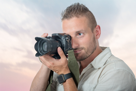 a young man photographer with dslr camera Stok Fotoğraf