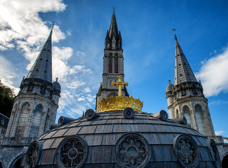 a view of the basilica of Lourdes in autumn, France Stock Photo