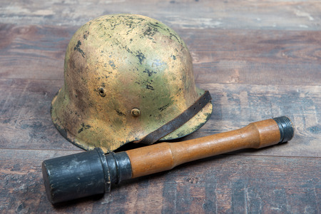 German World War Two (Stahlhelm) military helmets with a grenade