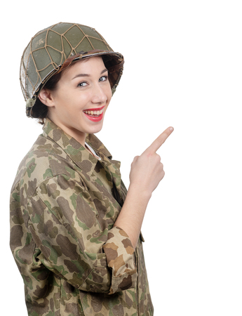 young woman dressed in American ww2 military uniform showing empty blank signboard with copy space