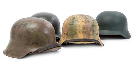 four German Army helmets World War II period isolated on a white background