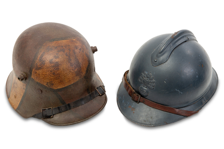 world war one french and german helmets on isolated the white background