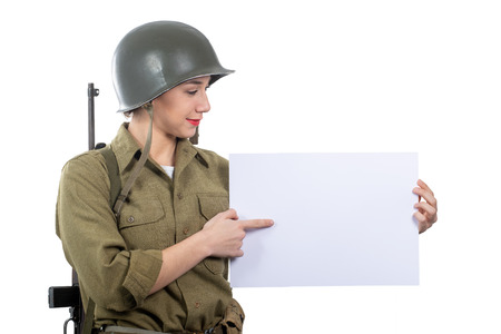 a young woman dressed in American ww2 military uniform showing empty blank signboard Imagens