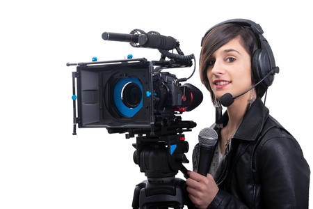 a pretty young woman  journalist with microphone in television studio on white