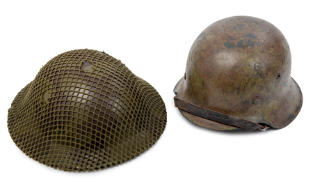 German and British World War Two military helmets, a battle of Normandy 1944
