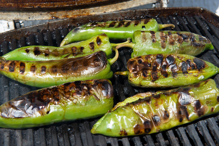 organic green peppers grilling on the barbecue