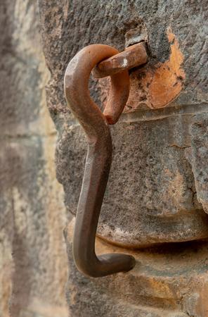an old rusty metal door hook Stock Photo
