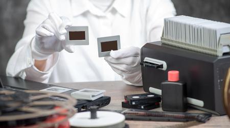 hand photographer digitize the film slide for saving