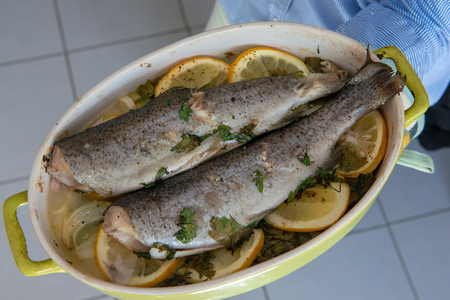the delicious two trouts with thyme and lemon and onion slices