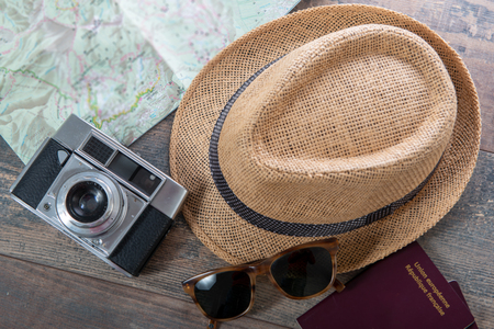 passports, map, summer hat and camera ready for the holidays