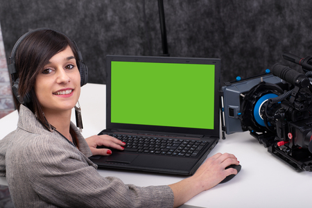 a young woman video editor working in studio