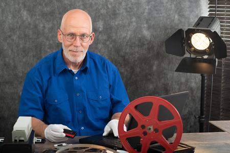 technician with white gloves digitizing a mini-DV cassette