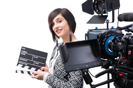 young woman holding a clapboard. video camera, Isolated on the white background Stock Photo - 124988828