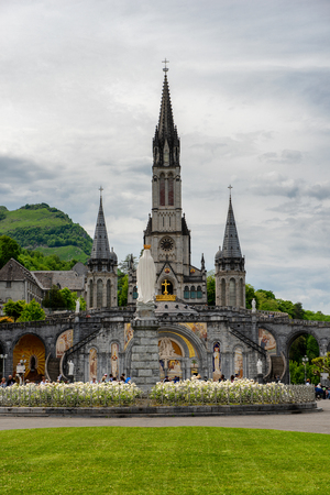 a view of the basilica of Lourdes in France Фото со стока