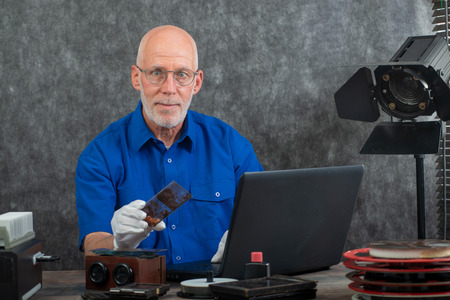 a technician with white gloves digitizing old photography on glass plate