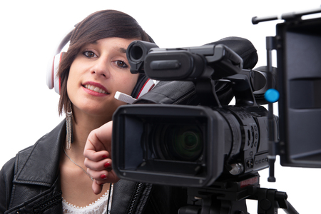 young woman with professional video camera, isolated on white background