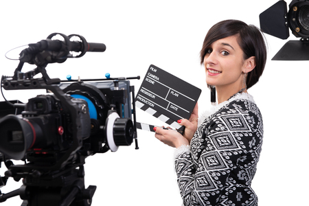 young woman holding a clapboard. video camera, Isolated on the white background Stock Photo