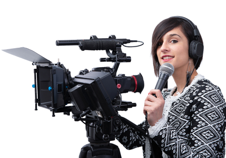 a pretty young woman  journalist with microphone in television studio on white Stock Photo - 124988917