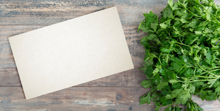 Organic parsley closeup on rustic wooden table with a copy space