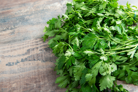 Organic parsley closeup on the rustic wooden table Reklamní fotografie