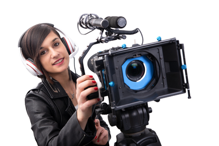 young woman with professional video camera, DSLR, isolated on white background
